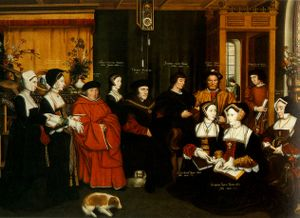 Thomas More, seated, surrounded by family members